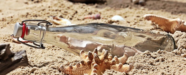 message in a bottle bottle post beach sand glass bottle letters mussels letter in bottle bottle beach beach beach beach beach