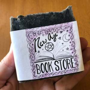 gray, black, and silver bar soap with label reading New Age Book Store