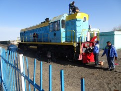 Painting an engine at the station