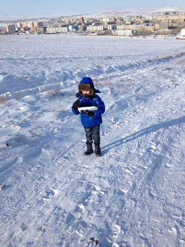 Noah playing with the snow.