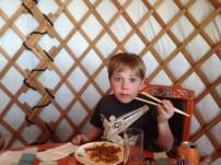Noah perfecting the art of chop sticks.