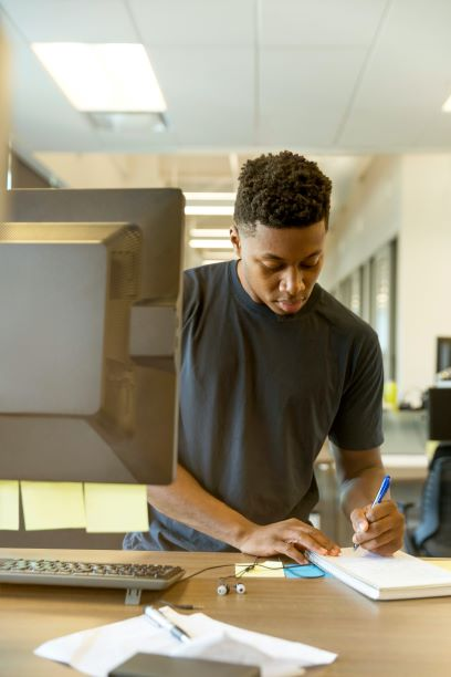 Young man learning on a PC