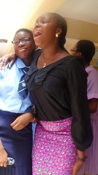 teacher-mrs-ani-embracing-and-singing-student-oguntoye-funmbi_17595998615_o
