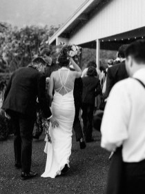bride and groom escaping the rain