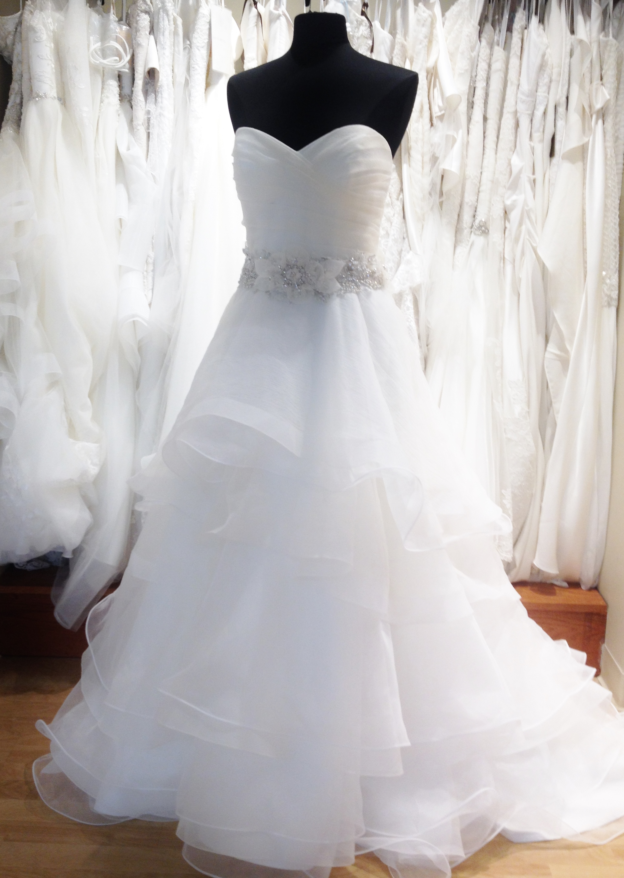 Tiered organza ball gown wedding dress with removable floral belt by Casablanca