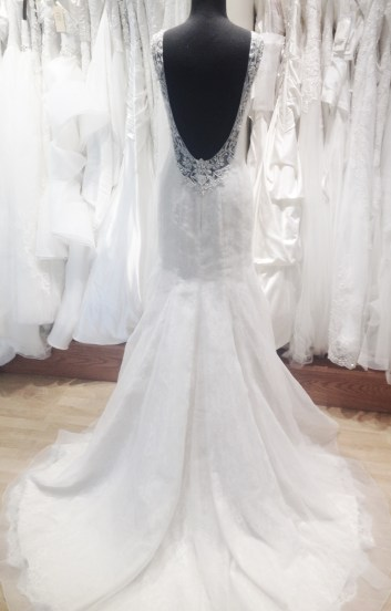 Beaded low back blush fit and flare wedding gown