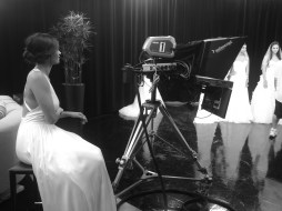 Kandrie watches from behind the cameras