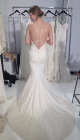 Low back shimmer spaghetti strap halter wedding dress by Nicole Miller