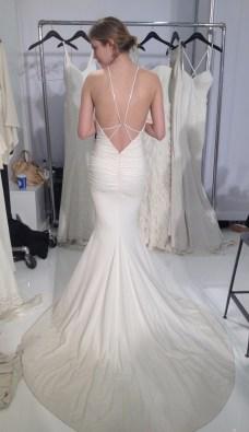 Low back shimmer spaghetti strap halter wedding dress by Nicole Miller