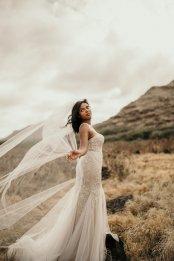 Cathedral veil and mermaid wedding dress at Masako Formals Hawaii