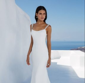 Crepe fit and flare wedding dress with low beaded back by Justin Alexander
