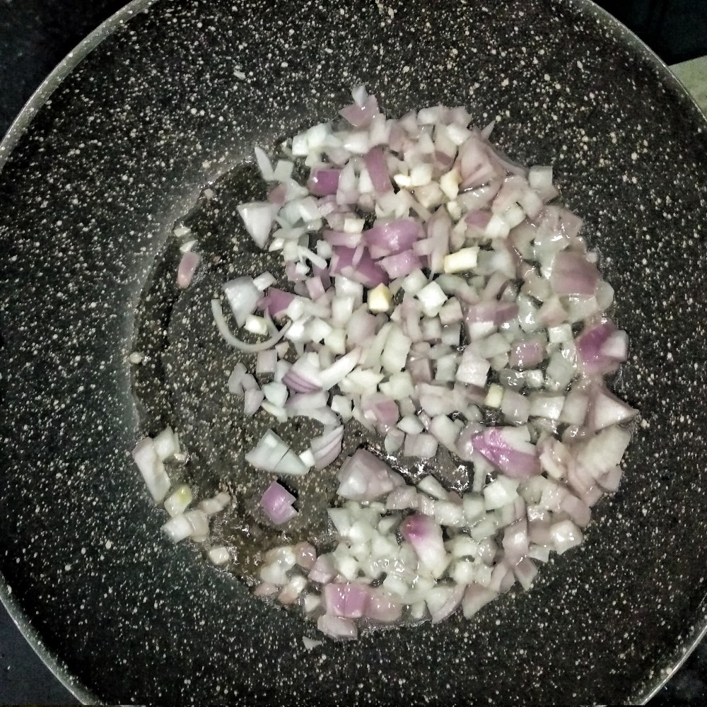 Add_chopped_onions_in_a_pan