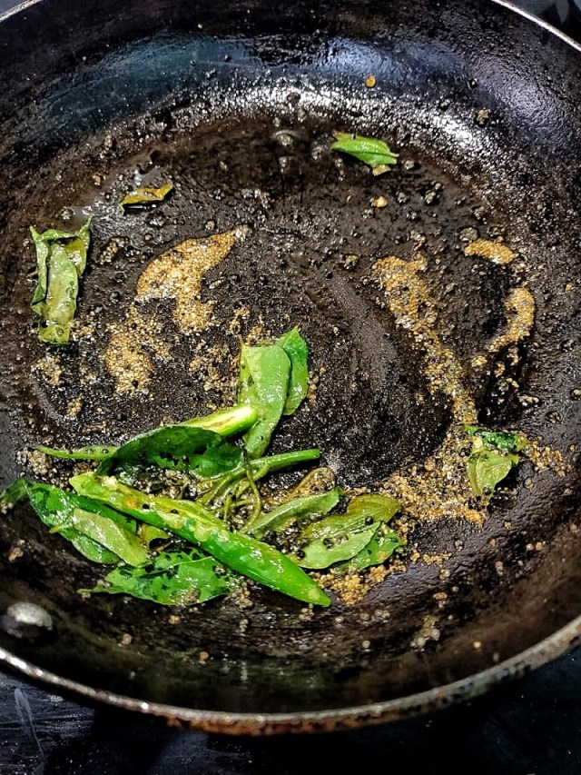 Add curry leaves and slit green chillies for tempering