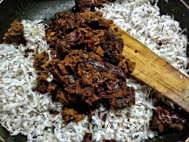 Add ground jaggery to the grated coconut