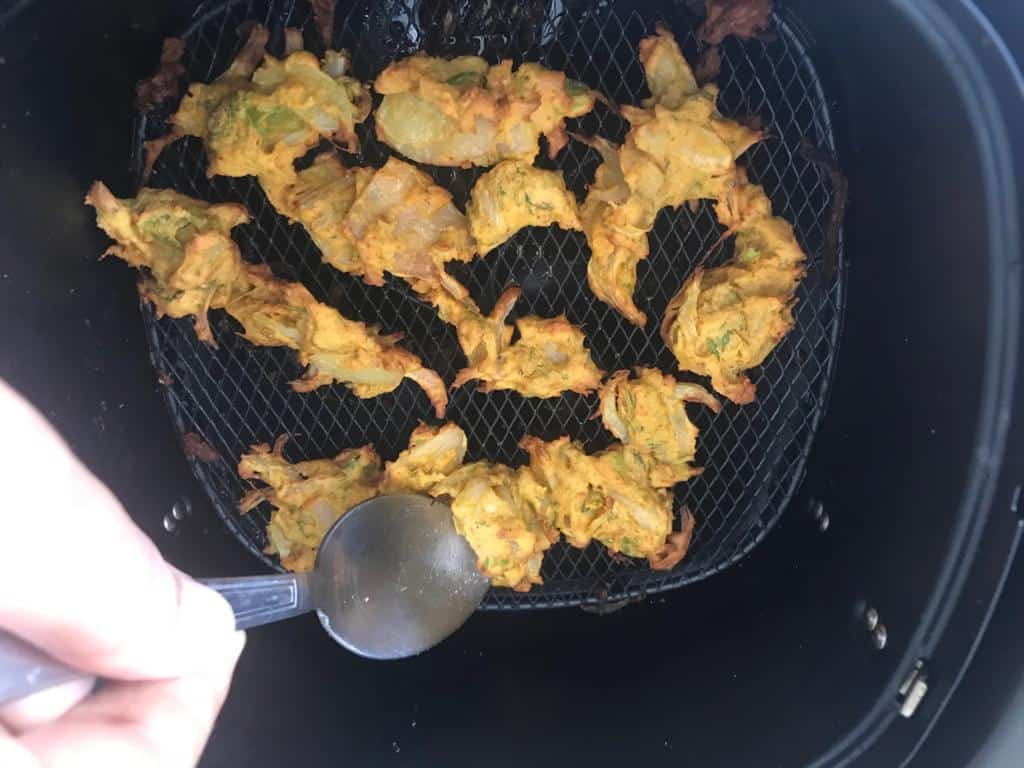 flipping the pakodas for even cooking