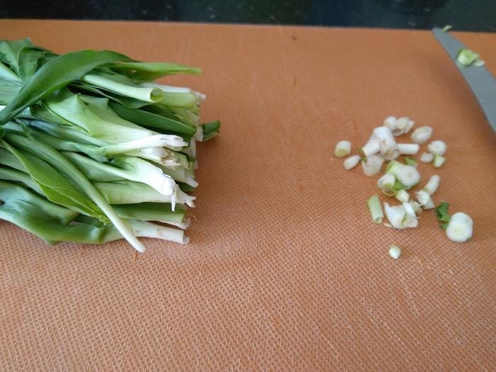 Finely chopping the Phodshi Bhaji