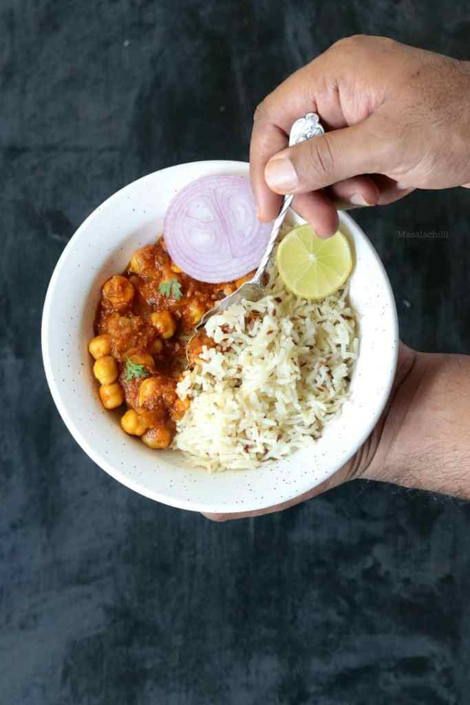Delicious bowl of Chana Masala served with Jeera Rice