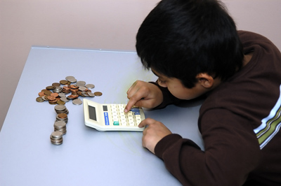 bigstock_Kid_Counting_His_Coins_small