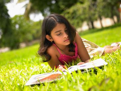 Asian Girl Reading A Book