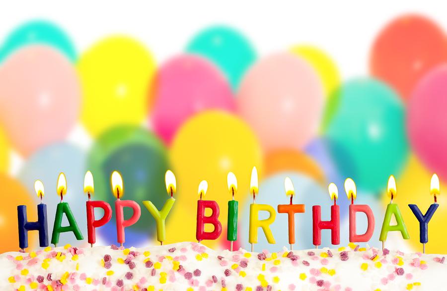 bigstock-Happy-birthday-lit-candles-on–31796636