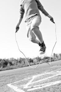 bigstock-kid-jumping-rope-on-playground-25727435