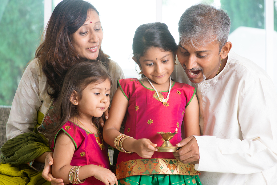 Indian family in traditional sari celebrate diwali or deepavali