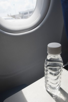 Water bottle on seat tray in an airplane