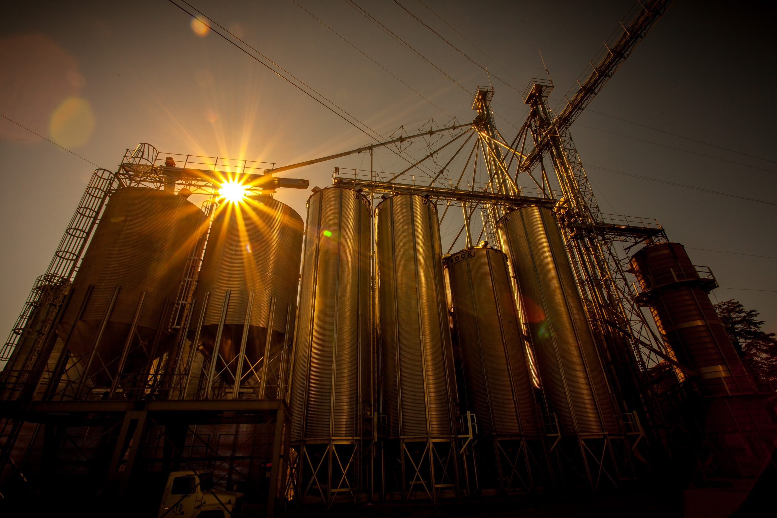 Gray metal industrial machine at golden hour