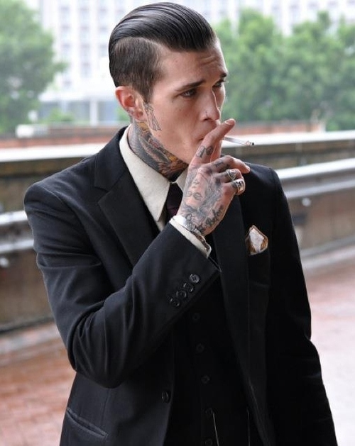 tattoos and suits