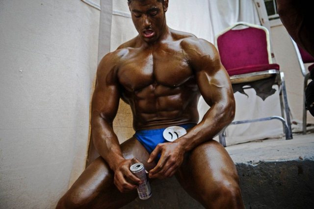 Fragile Monsters: Arab Body Building : Competitor takes a break