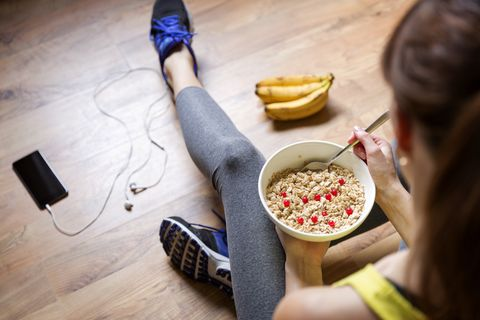 young girl eating a oatmeal with berries after a royalty free image 873937380 1547740219