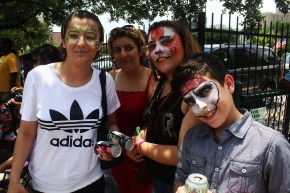 Families with painted faces feeling festive