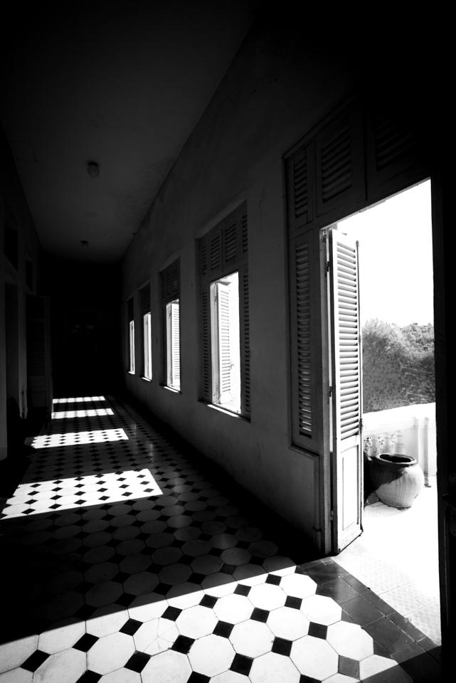 otdoor light spills into the open window and doors onto tiled floor