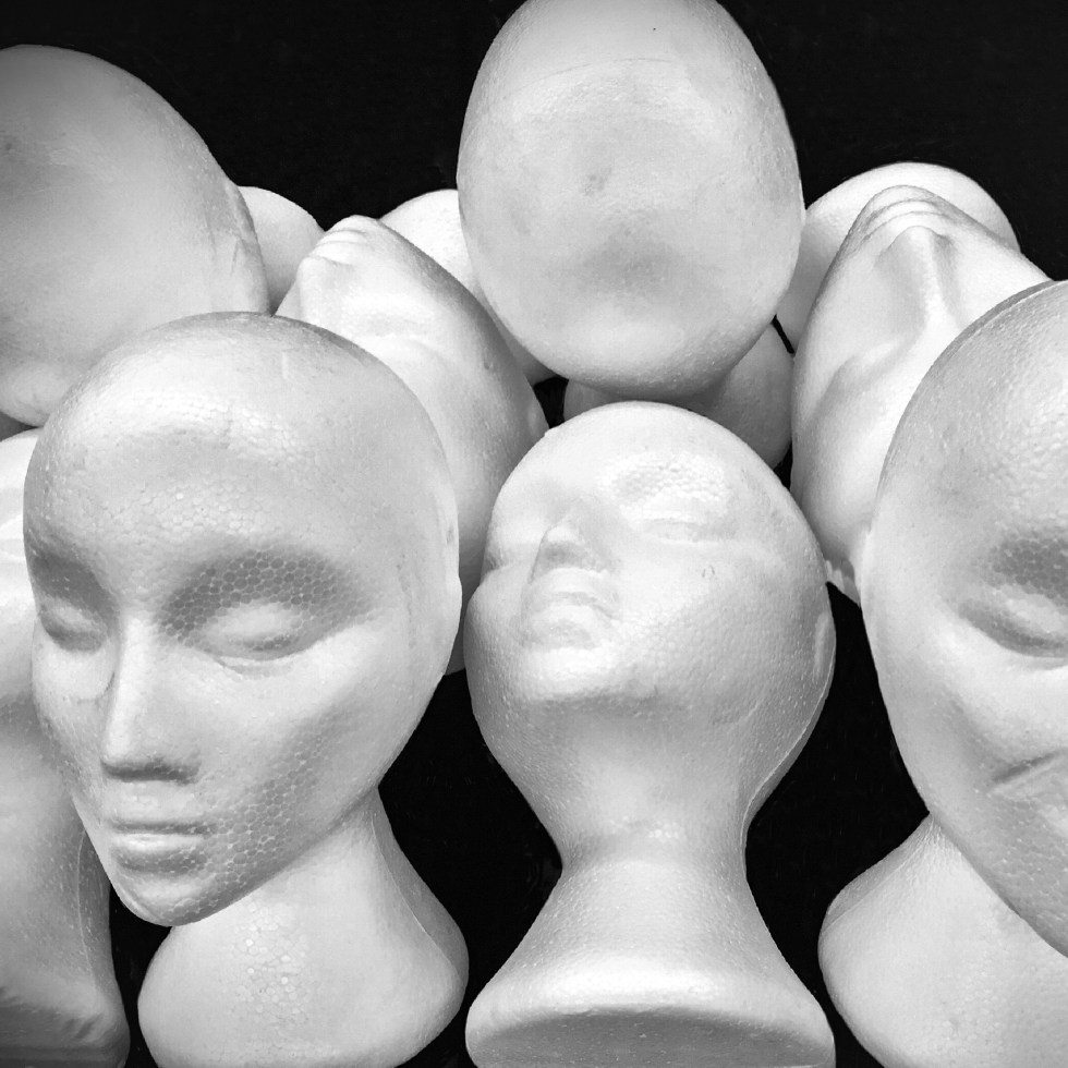 Model foam Heads show in black and white as an abstract picture and graphic position