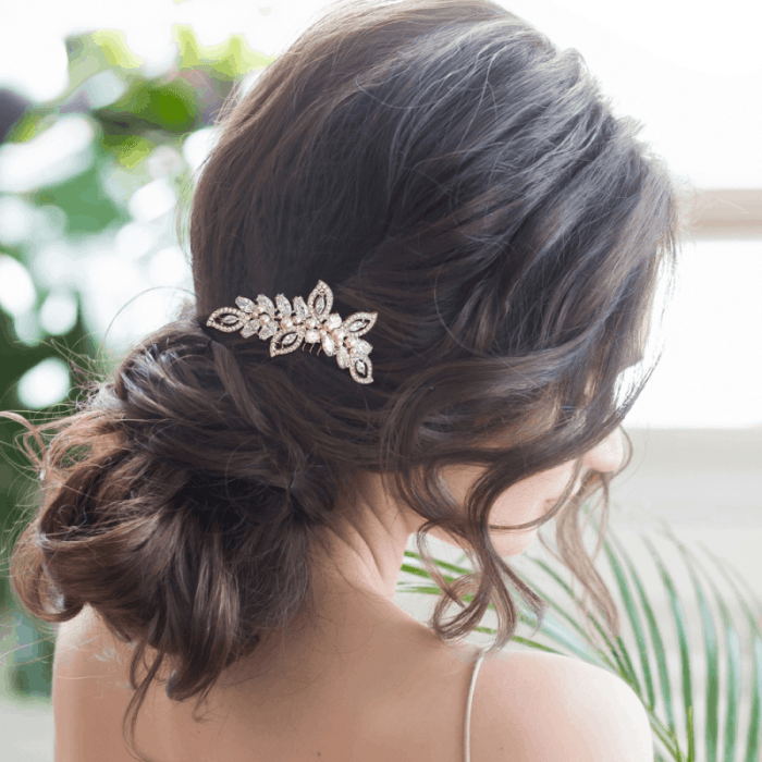Our classic brides will love our Cassandra hair comb. Providing beautifully crafted hand man-made ivory pearls on a silver finish.