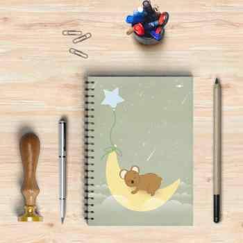 Libreta con el dibujo de un oso durmiendo bajo la luna