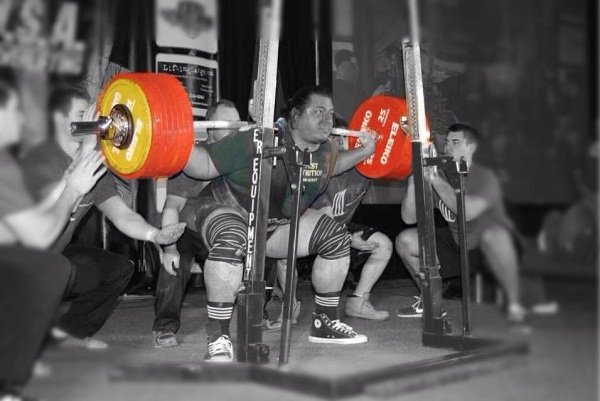 Joseph Cappellino taking 892lbs for a ride in the squat