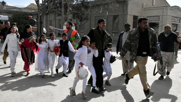 Policemen guide people after gunmen attacked the Bethel Memorial Methodist Church in Quetta, Pakistan December 17, 2017. REUTERS/Naseer Ahmed - RC11A7104CD0