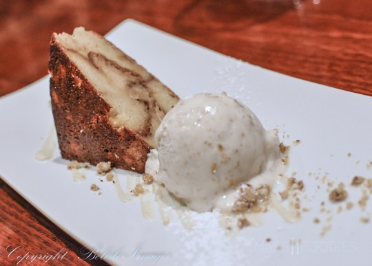 The final course from chef Tim Russo's Chef's Tasting Menu at Lock 50 in Worcester, MA. Cinnamon and spice bread pudding on a brown butter sauce with a scoop of house-made brown butter ice cream