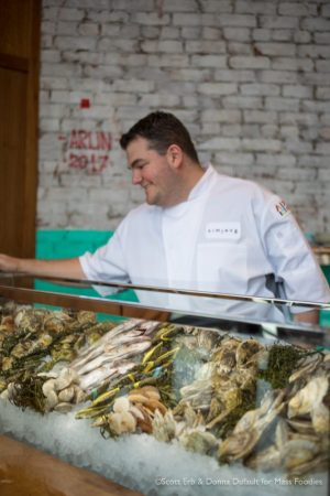 Executive Chef Jared Forman standing behind the raw bar display at simjang on Shrewsbury Street in Worcester, MA (Erb Photo for Mass Foodies)