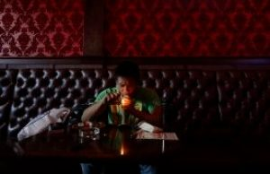 In this March 1, 2018 photo, Michael Leonor smokes marijuana in the smoking lounge at Barbary Coast Dispensary in San Francisco. San Francisco plans to issue more permits for marijuana smoking lounges this year after health officials finalize updated regulations. (AP Photo/Jeff Chiu)