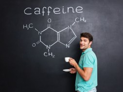 Happy scientist drinking coffee over chemical structure of caffeine molecule