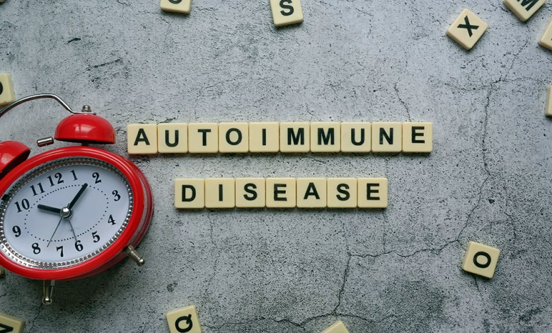 Selective focus of wooden block written with AUTOIMMUNE DISEASE