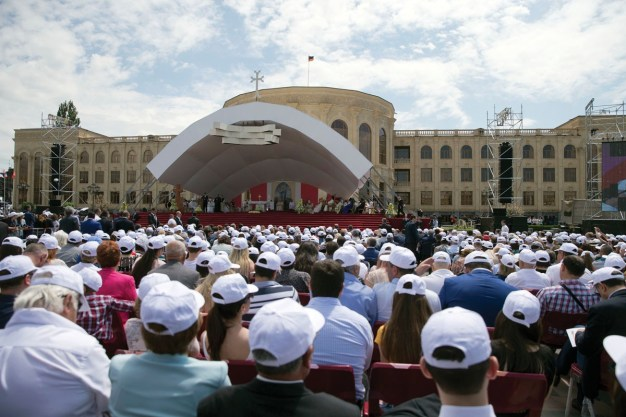 Faithful attend a mass celebrated by Pope Francis in Vartanants Square, in Gyumri, Armenia, Saturday, June 25, 2016. Pope Francis is in Armenia for a three-day visit. (AP Photo/Andrew Medichini)