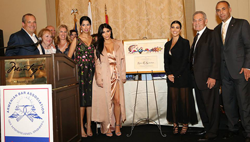Kim and Kourtney Kardashian flanked by Tina Odjaghian, uncle Tommy Kardashian, Armen Hovannisian and members of the Kardashian family.
