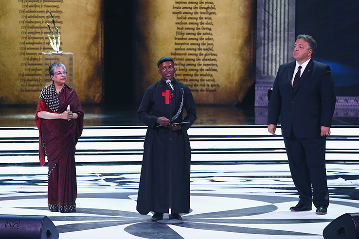Aurora Prize Selection Committee Member Hina Jilani and 100 LIVES Co-Founder Noubar Afeyan listen as Father Bernard Kinvi, a Catholic priest in Bossemptele in the Central African Republic, speaks at the Aurora Prize ceremony in Yerevan