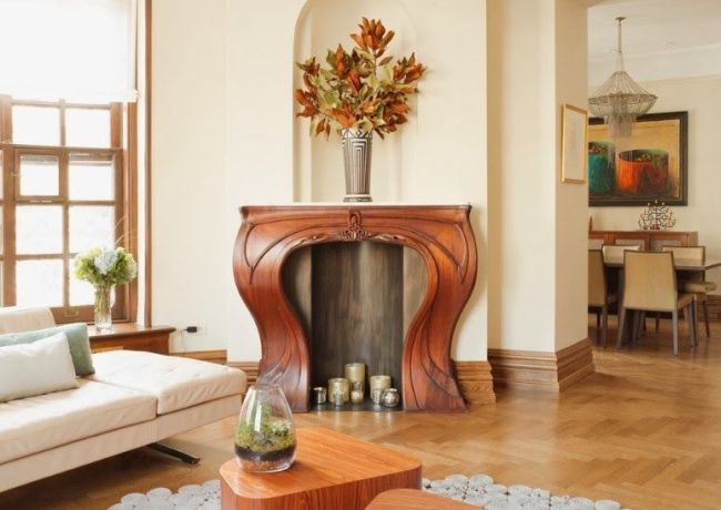 Gorgeous wooden portal for handmade fireplace