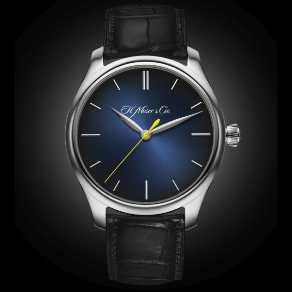 "Endeavour Centre Seconds Automatic, reference 1200-0203, white gold model, Midnight-blue fumé dial with yellow seconds hand: the model created by H. Moser & Cie. exclusively for Ernst & Young and awarded to the Swiss ""Entrepreneur of the YearTM"" winners."
