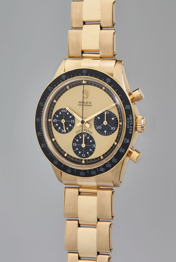 """Rolex, Reference 6264 - An extraordinarily rare, extremely attractive, and important yellow gold chronograph wristwatch with """"Paul Newman Lemon"""" dial and service guarantee, circa 1969"""
