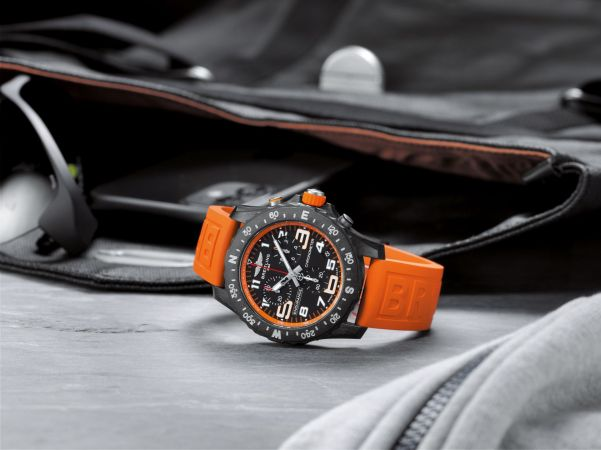 Breitling Endurance Pro with an orange inner bezel and rubber strap